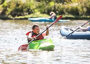 Youth paddling kayak